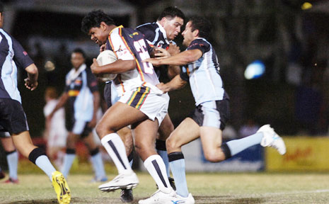 UNITED FRONT: Northern United's Dean Edwards pushes through the Wollumbin defence at the 2007 Aboriginal rugby league knockout carnival.