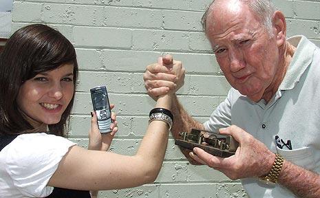 Jenna McKinnon (left) battles it out with Ken McPherson.