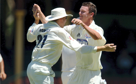 Josh Hazlewood, right, celebrates the wicket of New Zealand's Aaron Redmond at the SCG yesterday. The teenager will be one of a number of up-and-coming young cricketers to play in Lismore later this month.