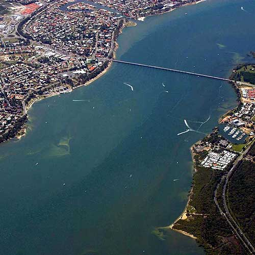 Urban sprawl: Sustainable growth was under question even in 2004, as South-east Queensland Regional Plan draft was released. Community concern remains on how sea-change meccas such as Bribie Island survive the population siege. Photo: Vicki Wood/c4062