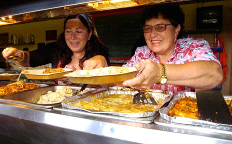 Lisa Gava and Melba de Re serve up some home-cooked Italian fare at the Lismore Italian Festival.