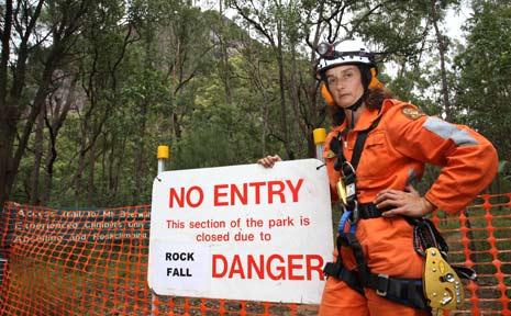 Glasshouse Mountains SES member Astrid Stevenson with the danger sign.