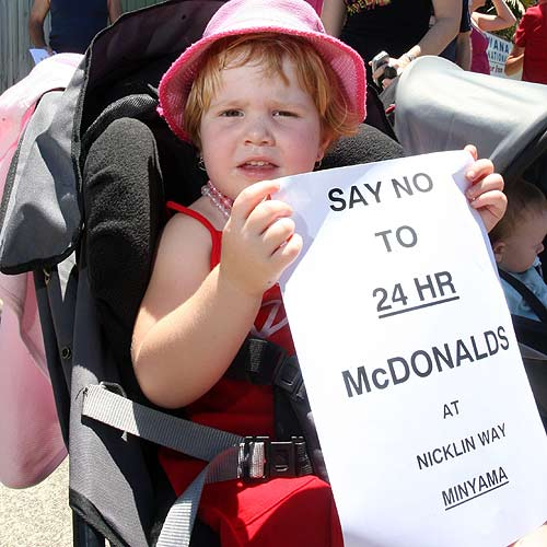 Minyama's 3-year-old Paige Dodgshun joined the protest against a 24-hour McDonalds. Photo: Nicholas Falconer/179695