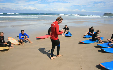 The Mojosurf students prepare to get into the water at Lennox Head on Thursday despite the beach being closed.