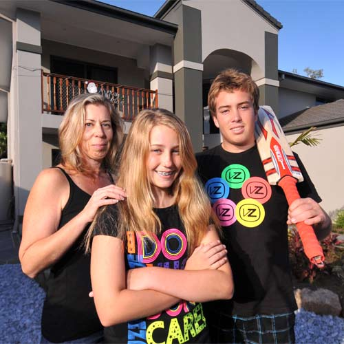 Bev Hassett and her children Shaylay and Benjamin are happy about the latest rates drop. Photo: Warren Lynam/179738