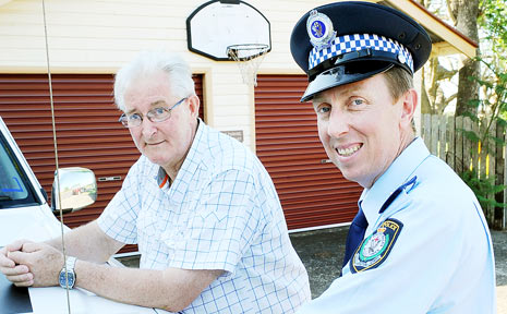 Bob Wilson, Alstonville Ratepayers' Association chairman, and Insp Greg Moore outside the Alstonville police station.