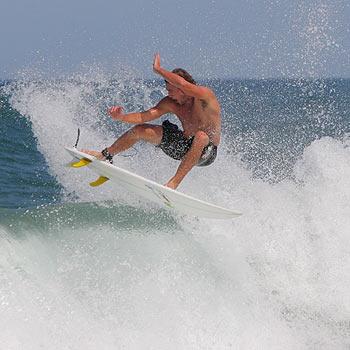 Dave Reardon-Smith waves goodbye to Yaroomba. Photo: Brett Wortman