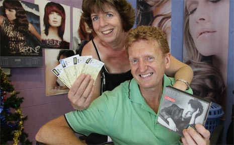 Neil Harvey and his wife Kathryn with their front-row tickets.