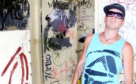 Byron skater Dan Drake in the vandalised toilet block.