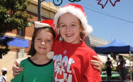 Rochelle Johnson and Mikaela Cooper at yesterday's Christmas Carnival in Magellan Street, Lismore.