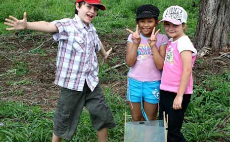 Bishop Druitt College students plant a tree in Bongil Bongil National Park.