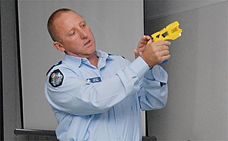 Senior Constable Gavin Hill demonstrates how the Taser stun gun works yesterday.