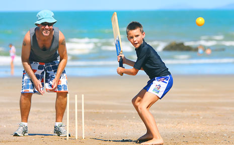 Slater Wright with his dad Cameron spend Boxing Day playing that iconic Australian game, beach cricket.