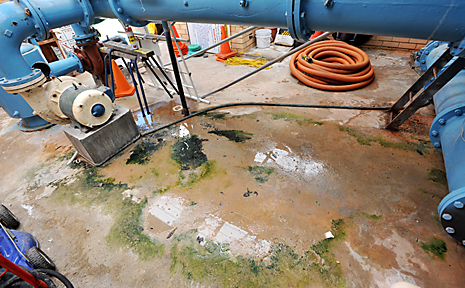 The pool's pump room, where the floor is constantly wet from leakage. BRUCE THOMAS