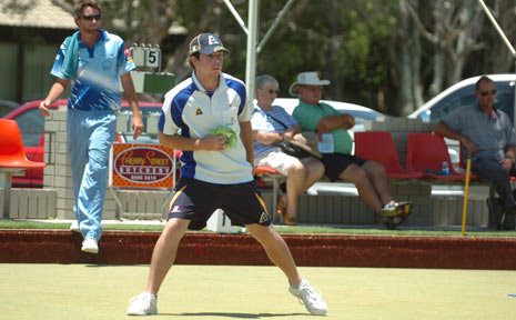 Gold Coast's Brent Cheyne 'encourages' his bowl to the right spot in the lead-up to yesterday's final of the Summerland Pairs at Ballina.