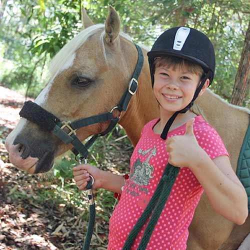 Bindi gives the thumbs up at the pony ride. Photo: Michaela O'Neill/180166