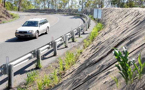 A new compacted dirt bund wall is expected to help stop vehicles rolling over the edge of the Peak Downs Highway over the Eton Range.
