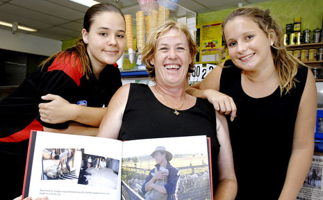 DROUGHT RELIEF: Ballina Ice Creamery part owner Renee Walker (centre) and shop assistants Elise Luhrs (left) and Mikayla Adams with a photo of Mudgee sheep farmer Michael Kiely who they have helped through raising money in their store.