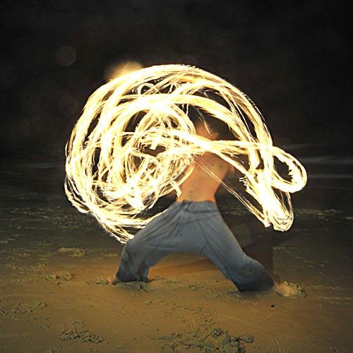 That's Chase Erbacher inside the whirl of flame on Mooloolaba beach. Photo: Brett Wortman/180302