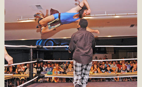 International Wrestling Australia came to Ballina RSL last Friday. Here, Apache Warrior jumps from the top rope onto Reggie Watson.
