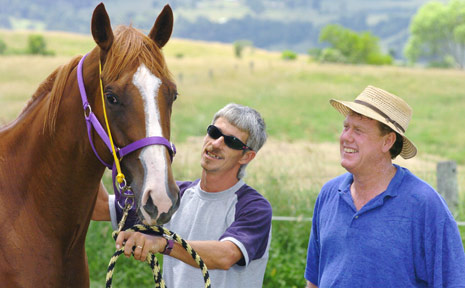 Owner Kevin Cocciola, far right, and trainer Owen Glue with Capilano Road.