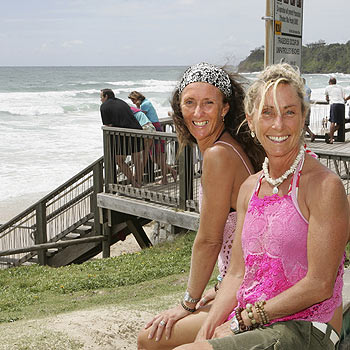 Lea Hunter and Lizette Morrison check out the king tide at Coolum Beach. Photo: Mike Garry/scw1273a