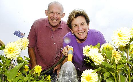 Ken and Ann Arthur in their Goonellabah garden.