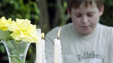At a service for missing Palmwoods teenager Daniel Morcombe, twin brother Bradley says a prayer for his missing brother