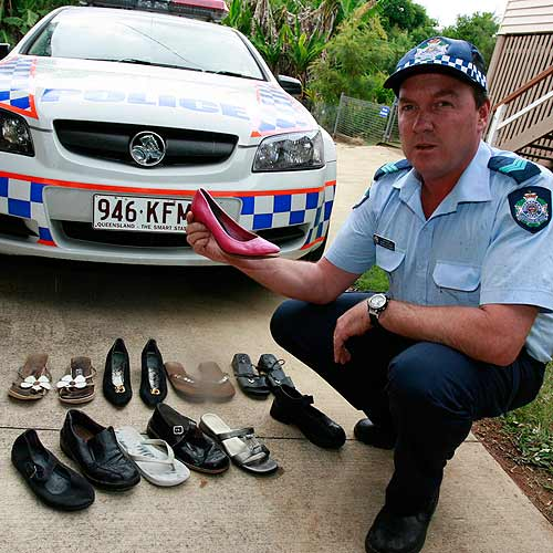 Sergeant John Latham shows the collection of shoes allegedly stolen in the local area. Photo:Barry Leddicoat/180517