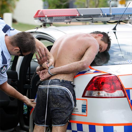 Police arrest a suspect alleged to have broken into homes and stolen property in the Maroochy Waters area. Photo:Jason Dougherty/180534