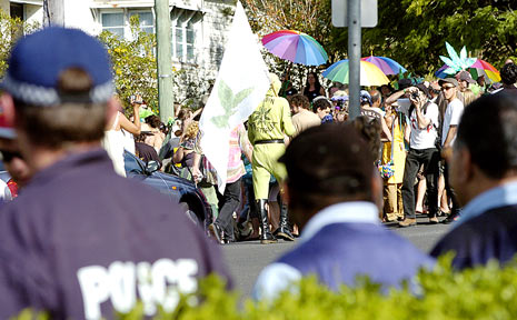 LOSING BATTLE: Police watch on as a pro-marijuana Nimbin Mardi Grass street parade gets under way to promote cannabis law reform in Australia.