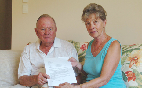 Stafford and Maruta Sheldon, of Oceania Court, with the letter they wrote to council suggesting pathways be left open, but barriers be erected.