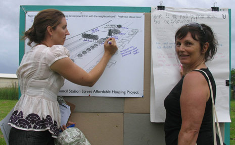 Colleen Lux (left) and Anne Garther have their say on the butchers' paper on site at Byron Council's proposed affordable housing development in Station Street, Mullumbimby.
