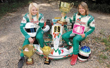IN THE BLOOD: Nichola, left, and Abbey Kellie with their swag of silverware won in go-kart racing.