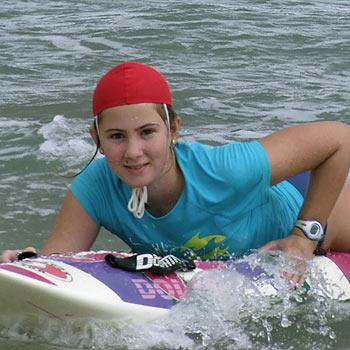Under-12 nipper Ellie Price enjoys the surf at Coolum. Photo: Peter Thompson