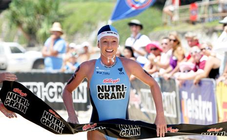 FORMER Yamba surf life saving star Alyce Bennett winning her first Nutri Grain ironwoman race.