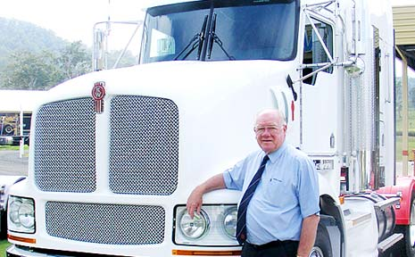 SALES ROCKETING: Jim Hurley with a Kenworth truck at Brown and Hurley, Kyogle.