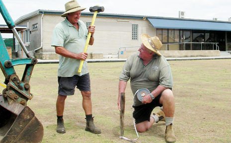 Brian Sutton helps Ron Skinner mark out redevelopment areas at the old Grafton Bowling Club.
