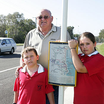 Sid Hillier with grandchildren Joe and Karla at the David Low Way bus stop. Photo: Mike Garry/scw1320