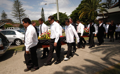 Pallbearers carry out the coffins of Aunty Lexie James and Phillip Wayne James from the Anglican Church in Ballina.