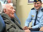 Allan Lodder is visited by RAAF wing commander Darren May. Photo: Brett Wortman/180939