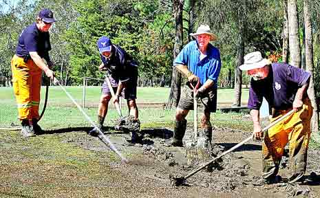 Mopping up after the floods at Urunga Golf Course.