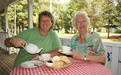 Serving tea on the verandah of Heritage House are Bangalow Historical Society members, left, vice-president Wendy Grissell and former president Betty Dengate.