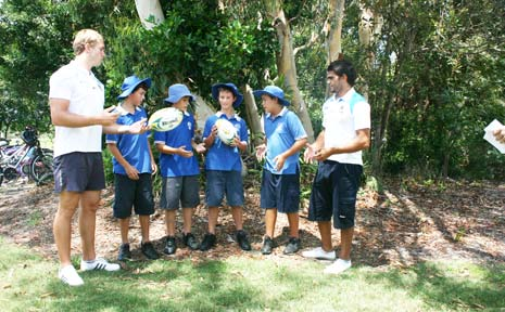 Gold Coast Titans players Kurt Froggo and Luke Dumas visited St Finbar's School on Monday to share training hints with students (from left) Bradley Maxwell, Liam Connellan, Dean Templeman and Sandon Mancell.