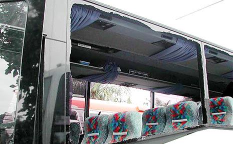 Smashed windows contributed to a $16,000 damage bill in this luxury coach.