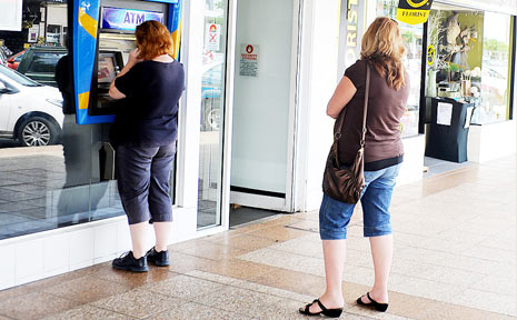HOLE IN THE WALL: Fees as high as $5 can now be charged by banks every time you make a transaction from a different bank's ATM machine.