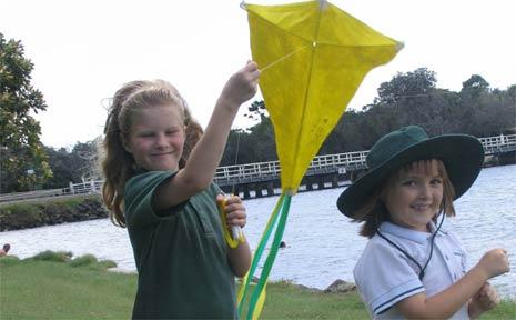 Getting ready to fly their kites at the Kites and Bikes Festival are Jade Lynden–Bell (left) and Grace O'Shannessy from Brunswick Heads Public School.