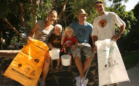 Getting ready to do their bit for Clean Up Australia Day at Byron Bay on Sunday are the Millis family from Suffolk Park (from left) mum Sorrell, three-and-a-half-year-old twins Kai and Jarra; dad Steve and Cape Byron Trust site co-ordinator Andy Robinson.