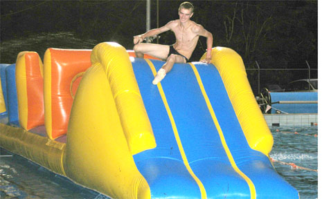 17-year-old Ashley Lumsden is a regular at Mullumbimby pool Friday nights, and has the fastest time on the inflatable in one of eight categories.