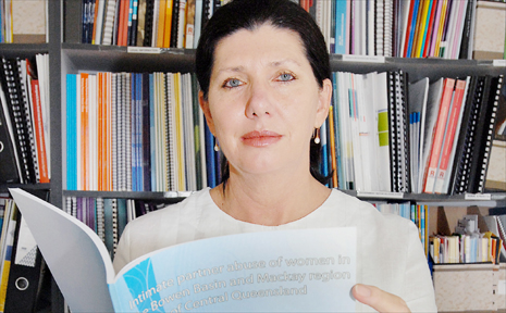 CDFVR director Heather Nancarrow looking through the report on Intimate Partner Abuse of Women in the Bowen Basin and Mackay region, where 500 women were surveyed.